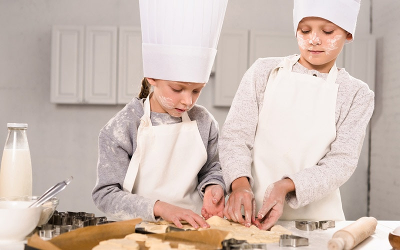 Kids baking cookies.